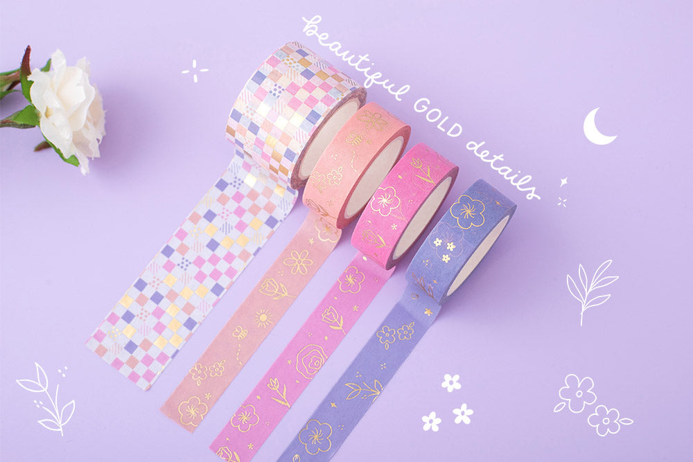 Tsuki Floral collection washi tapes with gold details rolled out on lilac background