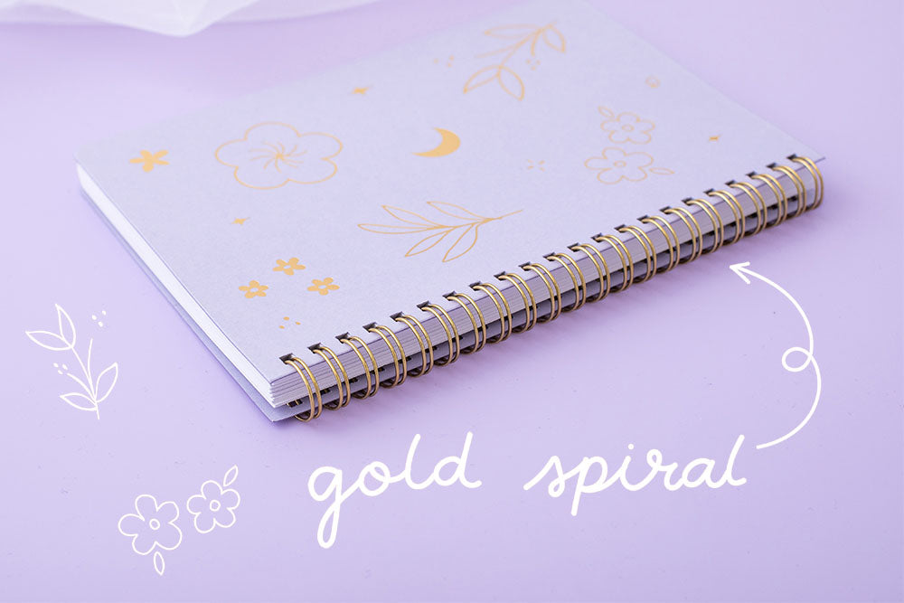 Gold Spiral facing lilac taro Floral ringboung notebook on lilac background