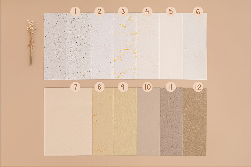Tsuki Mixed Scrapbook Paper Pack with dried flowers on beige background