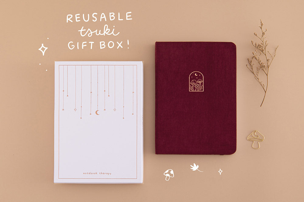 Tsuki 'Kinoko' Limited Edition Bullet Journal with reusable tsuki gift box and free paperclip gift with dried flowers on beige background