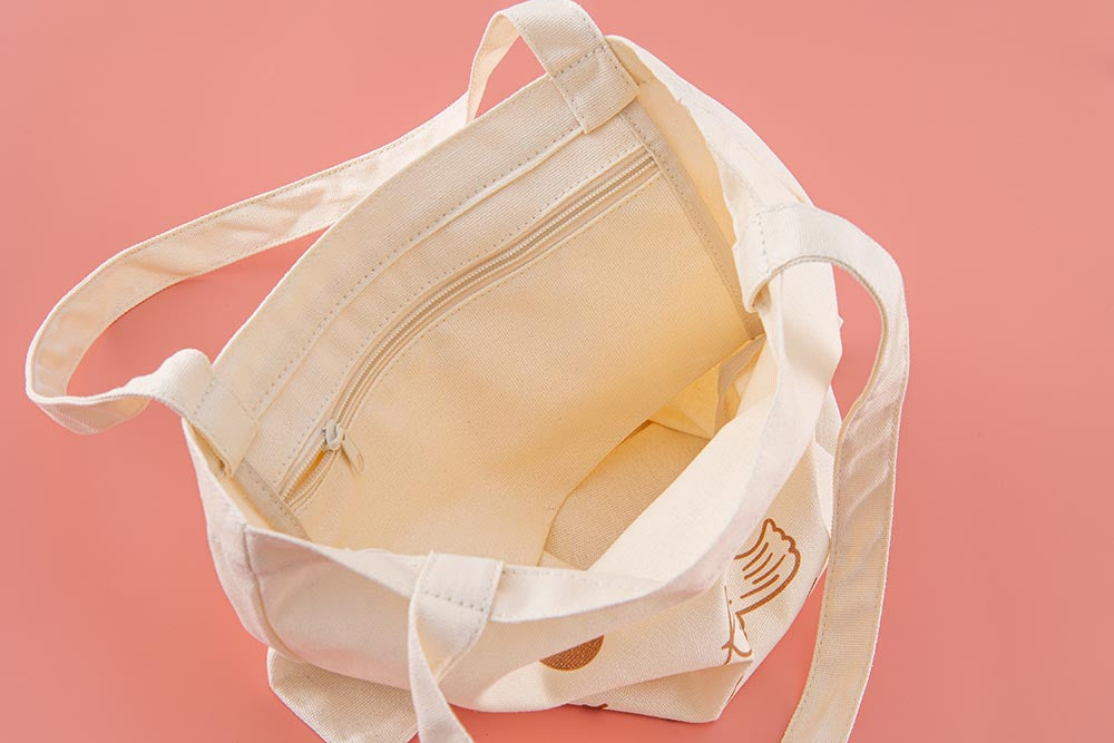 Close up of the inside of Tsuki 'Moonflower' Limited Edition Tote Bag on coral pink background