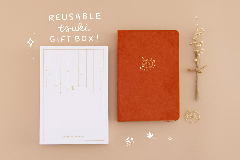 Tsuki 'Kitsune' Limited Edition Fox Bullet Journal with reusable tsuki gift box and free paperclip gift with dried flowers on beige background