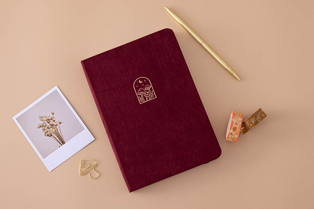Tsuki 'Kinoko' Limited Edition Bullet Journal with free paperclip gift with Tsuki 'Maple Dreams' Washi Tapes and gold pen and dried flowers on beige background