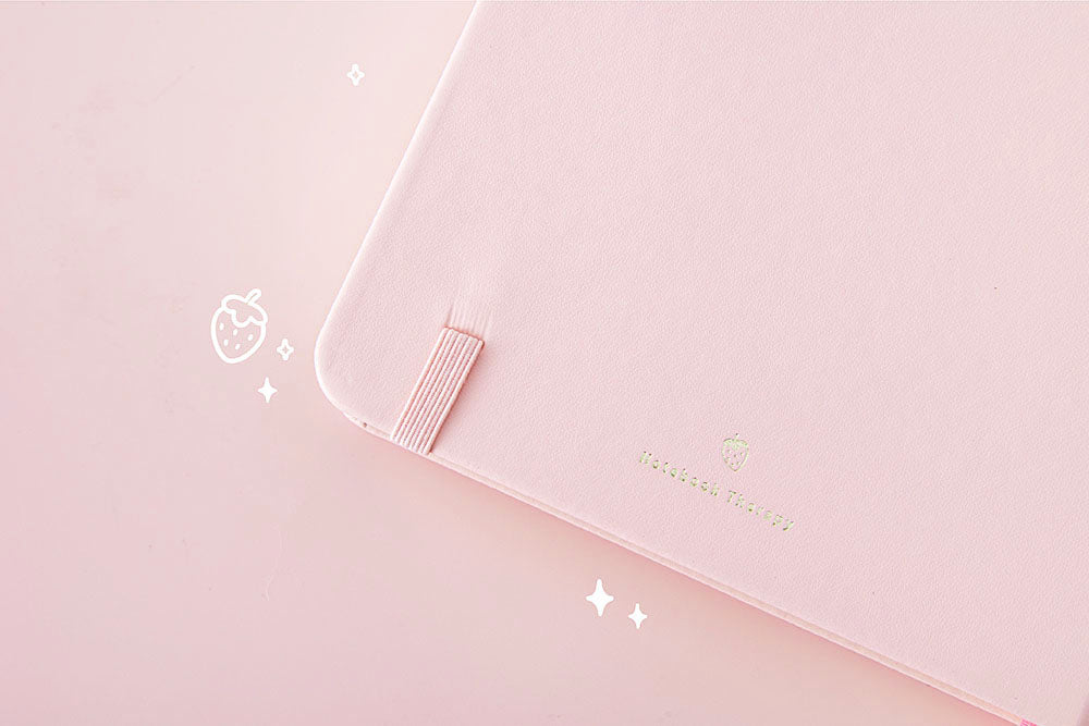 Close up of back page cover of Tsuki 'Ichigo' Limited Edition Boba Bullet Journal on light pink background