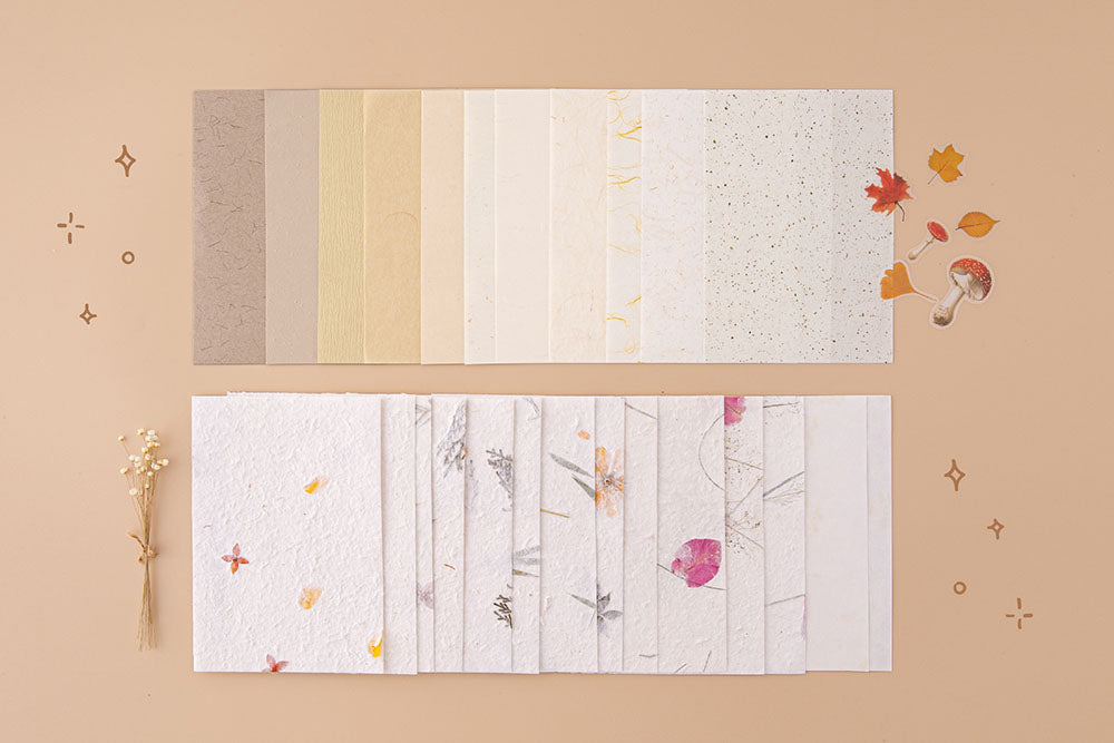 Tsuki Handmade Petal Papers with Tsuki Mixed Scrapbook Paper Pack with free mushroom stickers and autumn leaves on beige background