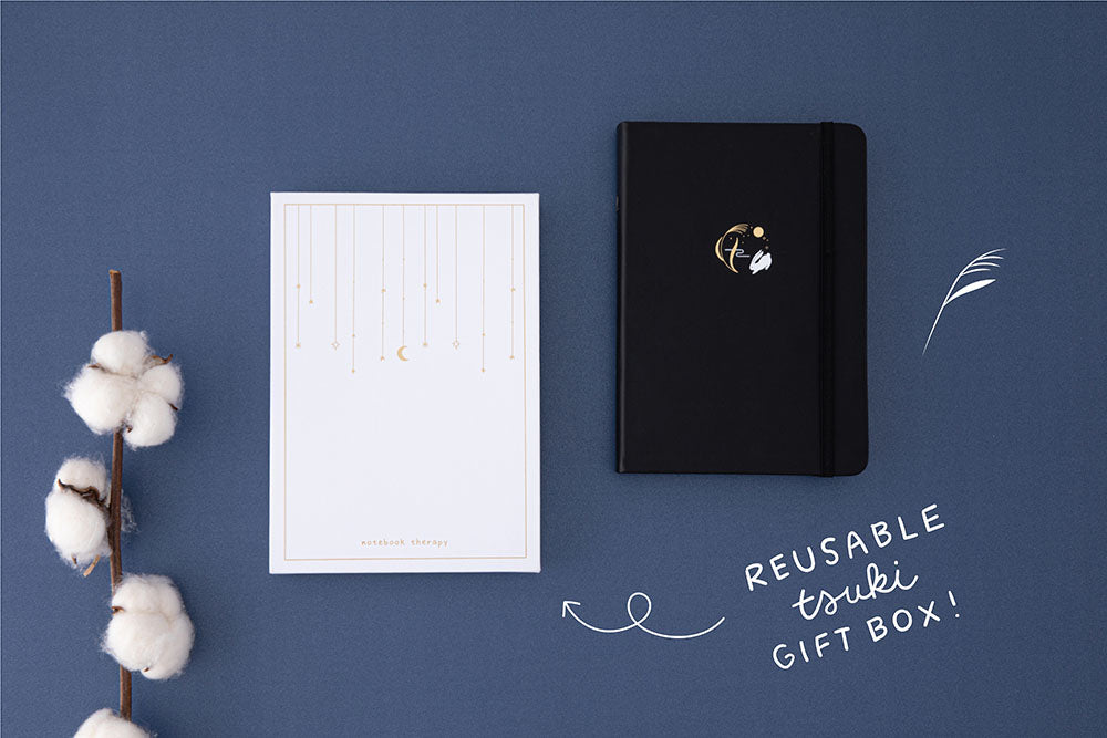 Tsuki 'Moonlit Wish' Limited Edition Bullet Journal with reusable Tsuki gift box with cotton flowers on dark blue background