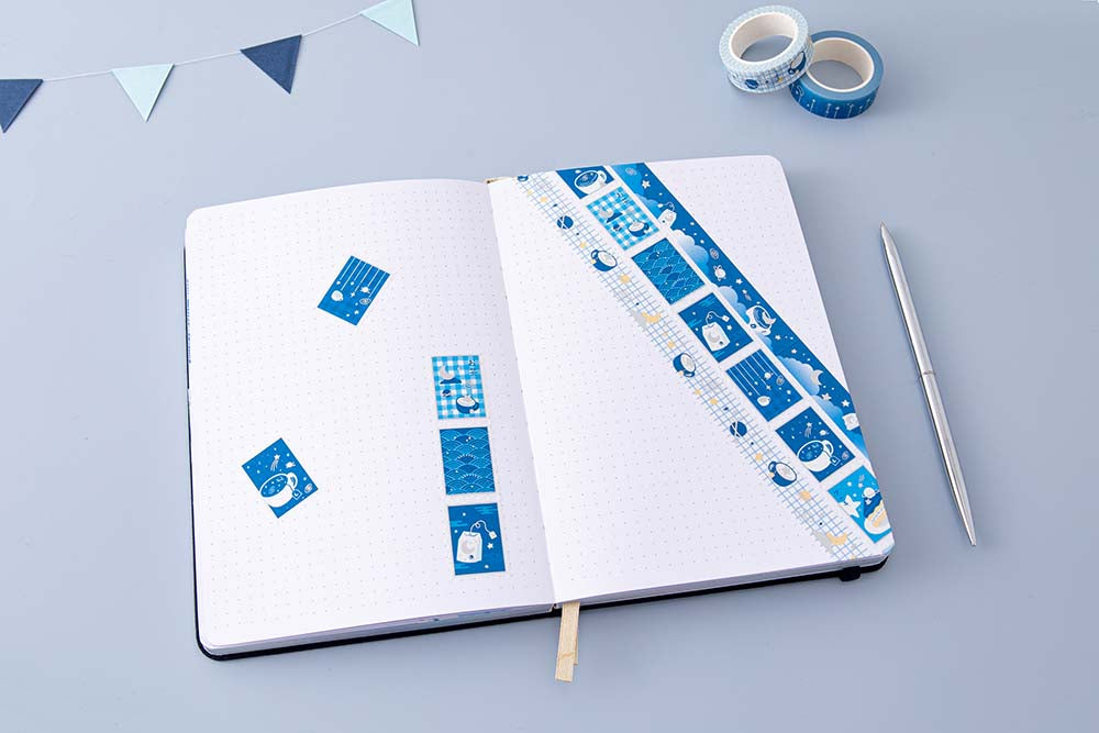Tsuki 'Cup of Galaxy' Washi Tapes on Tsuki 'Cup of Galaxy' Limited Edition Holographic Bullet Journal with bunting and silver pen on light blue background
