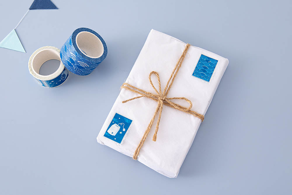 Tsuki 'Cup of Galaxy' Washi Tapes on wrapped gift with bunting on light blue background