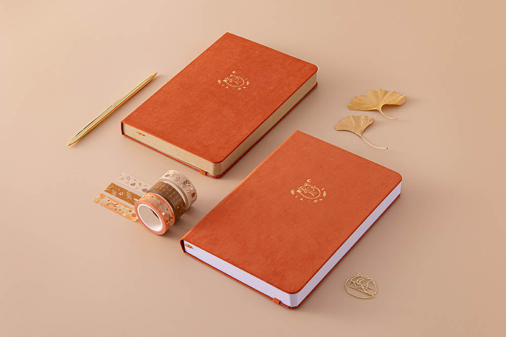 Tsuki 'Kitsune' Limited Edition Fox Bullet Journal with Tsuki 'Kitsune' Kraft Paper Limited Edition Fox Notebook and Tsuki 'Maple Dreams' Washi Tapes and autumn leaves and gold pen on beige background