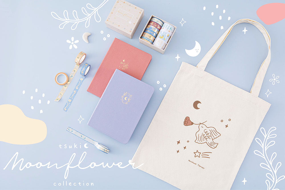 Tsuki Moonflower Collection including 'Suzume' Limited Edition Bullet Journal and 'Full Bloom' Limited Edition Notebook and 'Moonflower' Washi Tape Set and 'Moonflower' Tote Bag on light blue background
