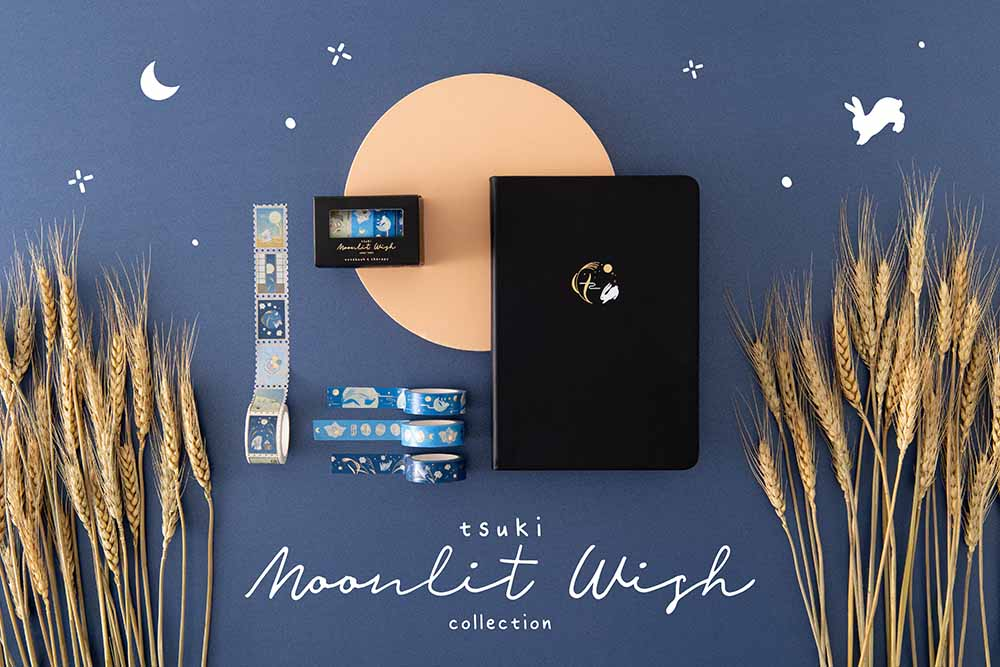 Tsuki Moonlit Wish Collection with Tsuki 'Moonlit Wish' Limited Edition Bullet Journal and Tsuki 'Moonlit Wish' Washi Tapes Set with wheat reeds on light brown circle on dark blue background
