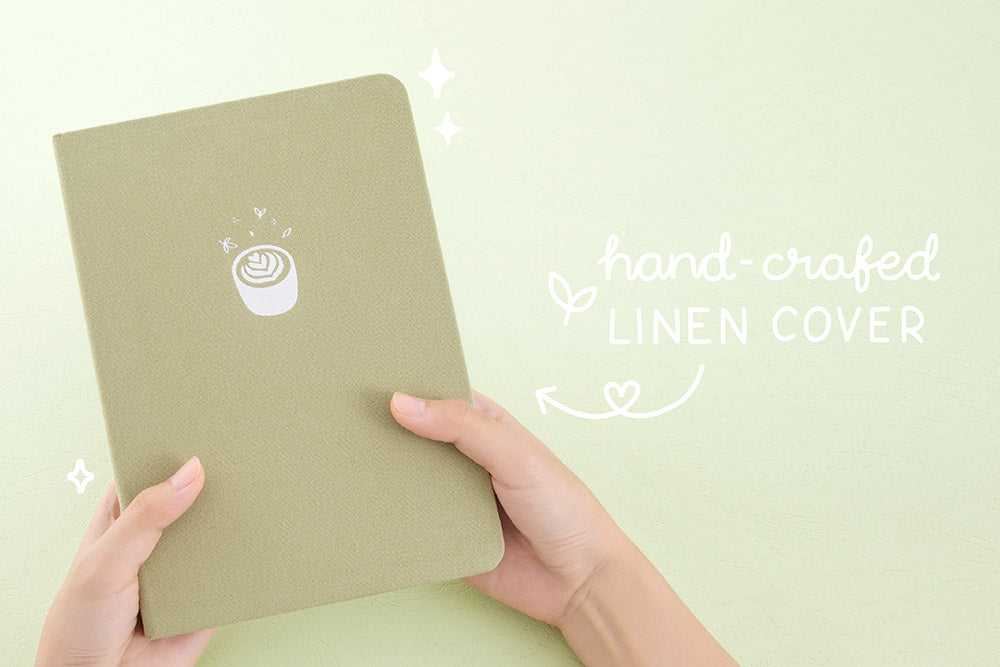 Tsuki 'Matcha Matcha' Limited Edition Bullet Journal with handcrafted linen cover held in hands in matcha green background