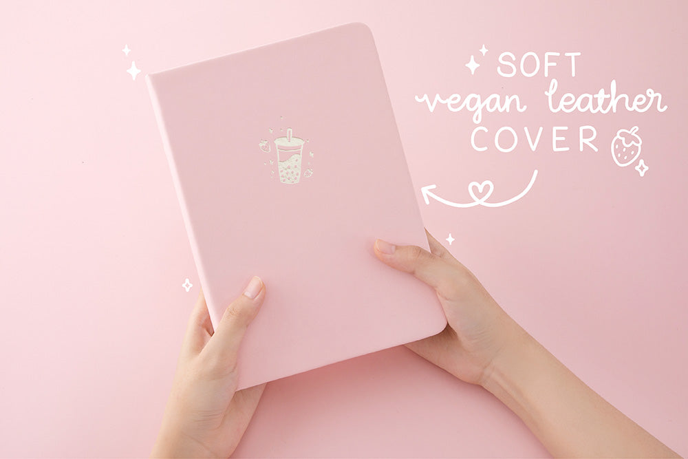 Tsuki 'Ichigo' Limited Edition Boba Bullet Journal with soft vegan leather cover held in hands in light pink background