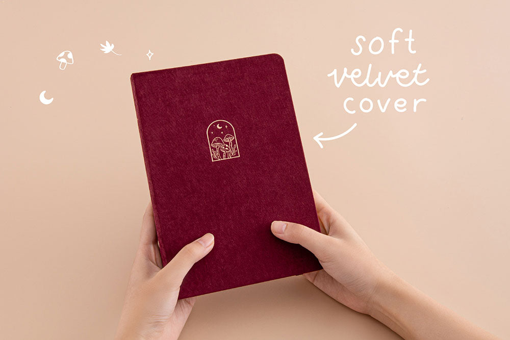 Tsuki 'Kinoko' Limited Edition Bullet Journal with soft velvet cover held in hands in beige background