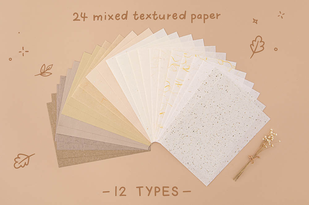 Tsuki Mixed Scrapbook Paper Pack with twenty-four mixed textures and two paper types fanned out on beige background
