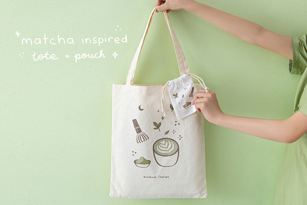 Tsuki 'Matcha Matcha' Tote Bag held in hands with free matcha inspired matching drawstring pouch in matcha green background