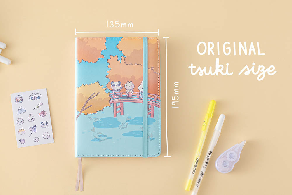 Tsuki 'Four Seasons: Autumn Edition' Bullet Journal made with milkkoyo in original tsuki size with free stickers sheet with pens and tape roller on light brown background