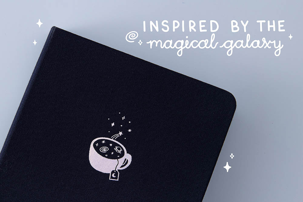 Close up of Tsuki 'Cup of Galaxy' Limited Edition Holographic Bullet Journal inspired by the magical galaxy on light blue background