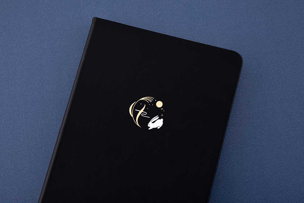 Close up of Tsuki 'Moonlit Wish' Limited Edition Bullet Journal on dark blue background
