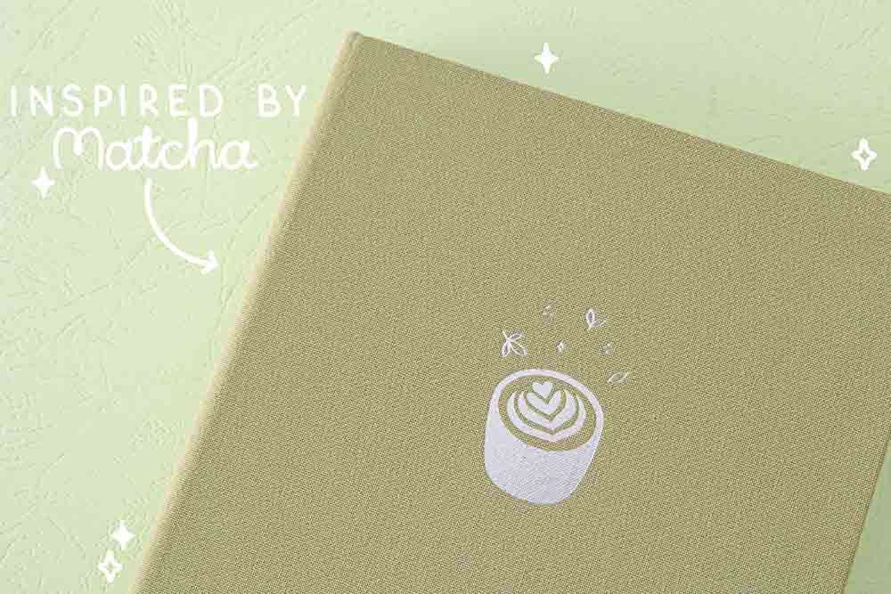 Close up of the front cover of Tsuki 'Matcha Matcha' Limited Edition Bullet Journal inspired by matcha on matcha green background