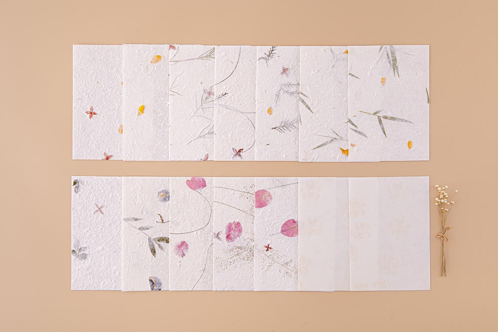 Tsuki Handmade Petal Papers with dried flowers on beige background