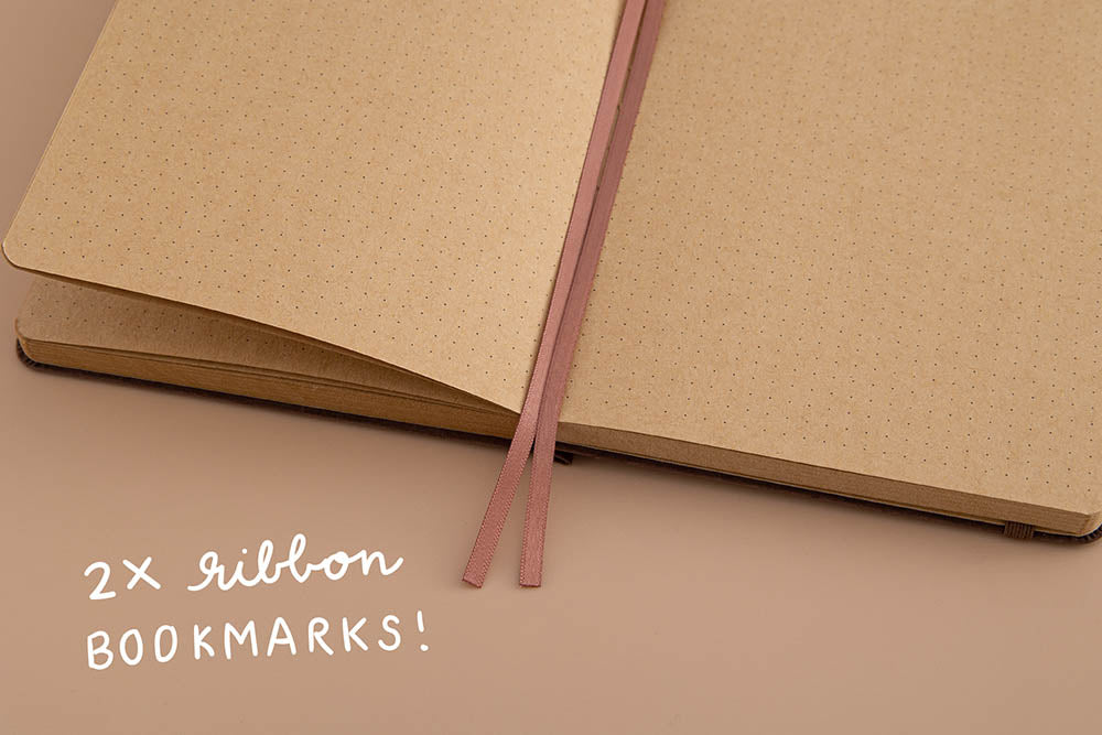 Tsuki Kraft Paper Limited Edition Bullet Journal in Nara with two bookmark ribbons on beige background