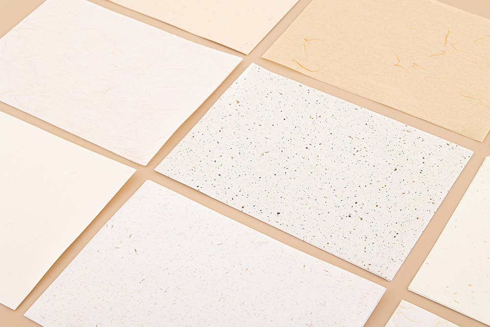 Tsuki Mixed Scrapbook Paper Pack laid out on beige background
