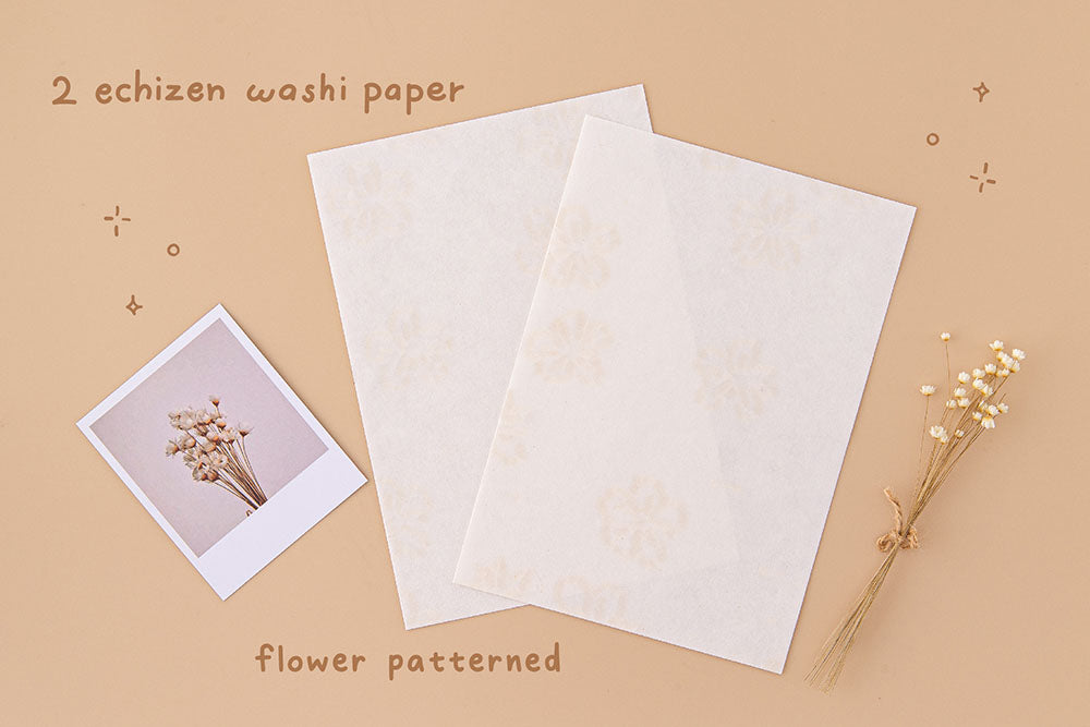 Tsuki Handmade Echizen Washi Petal Papers with flower pattern with dried flowers and polaroid picture on beige background