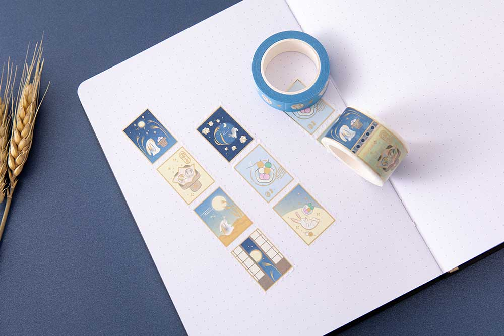 Tsuki 'Moonlit Wish' Washi Tapes on open bullet journal pages with wheat reeds on dark blue background