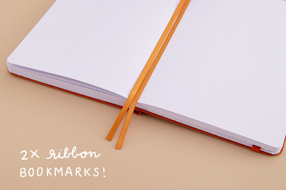 Open page spread of Tsuki 'Kitsune' Limited Edition Fox Bullet Journal with two bookmark ribbons on beige background