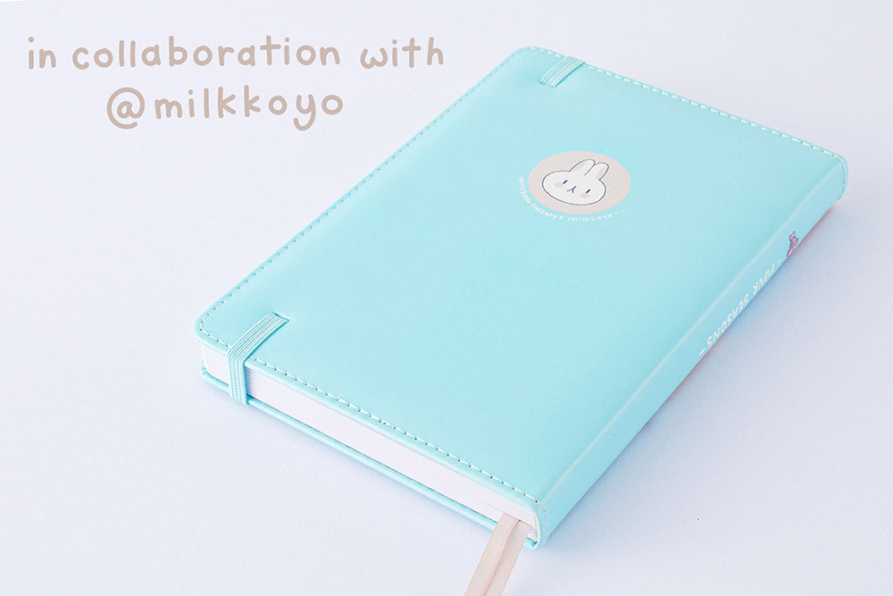 Back cover of Tsuki 'Four Seasons: Autumn Edition' Bullet Journal made in collaboration with milkkoyo on lilac background