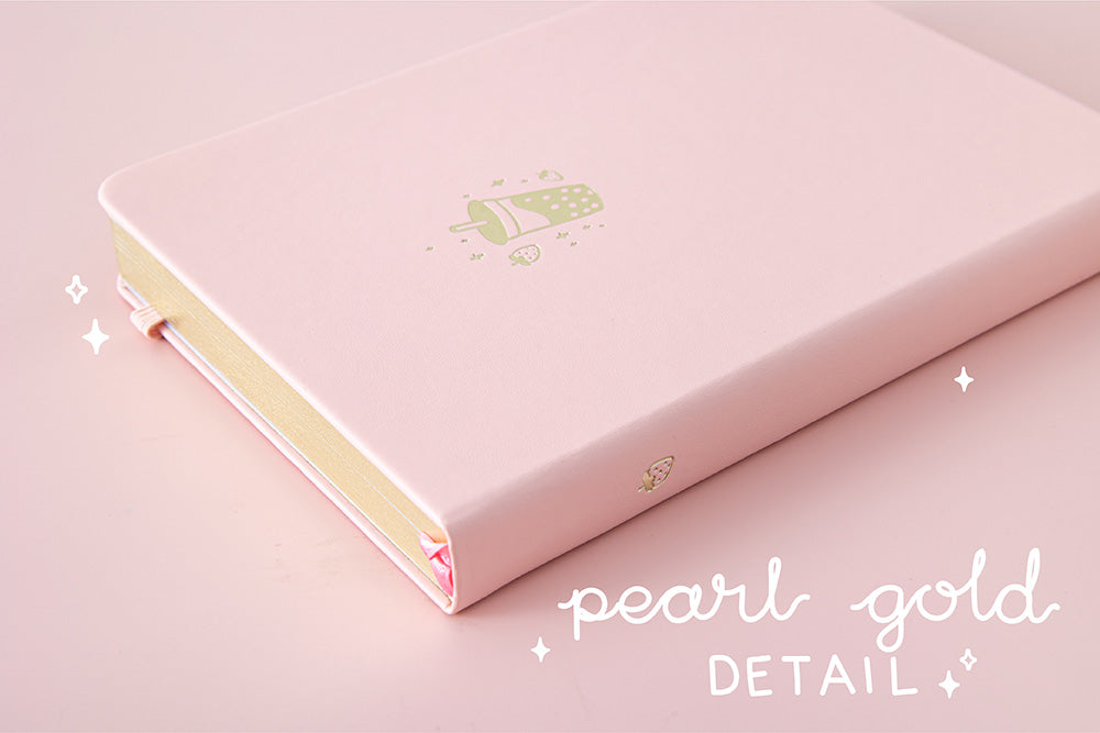 Close up of Tsuki 'Ichigo' Limited Edition Boba Bullet Journal with pearl gold details on light pink background