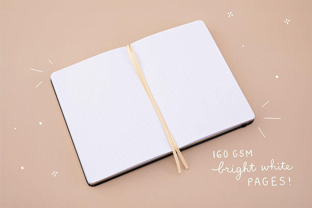Open page spread of Tsuki 'Moonlit Wish' Limited Edition Bullet Journal with 160GSM bright white pages on light brown background