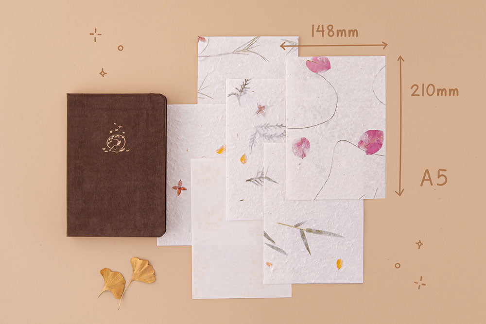 Tsuki Handmade Petal Papers in A5 size with Tsuki 'Nara' Limited Edition Bullet Journal and autumn leaves on beige background