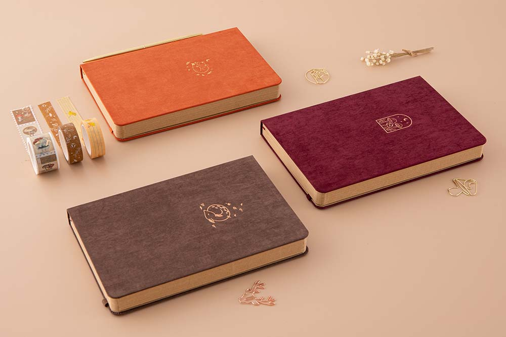 Tsuki Kraft Paper Limited Edition Bullet Journals in Nara and Kitsune and Kinoko with free bookmark gifts and Tsuki 'Maple Dreams' Washi Tapes with dried flowers on beige background