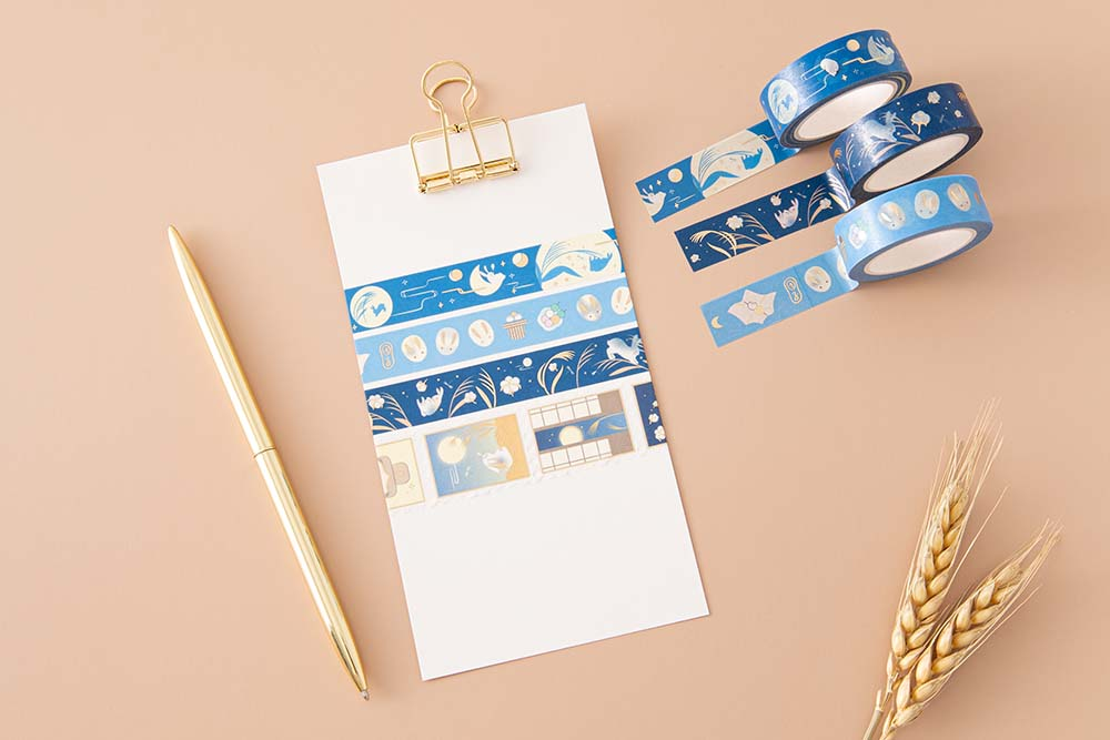 Tsuki 'Moonlit Wish' Washi Tapes on white clipboard with gold pen and wheat reeds on light brown background