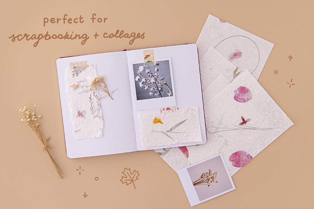Tsuki Handmade Petal Papers perfect for scrapbooking and collages on open bullet journal spread with dried flowers and polaroid picture on beige background