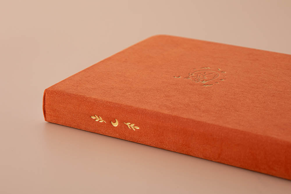 Close up of spine of Tsuki 'Kitsune' Limited Edition Fox Bullet Journal on beige background