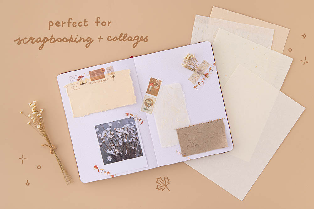 Tsuki Mixed Scrapbook Paper Pack perfect for scrapbooking on open bullet journal page with polaroid picture and dried flowers on beige background
