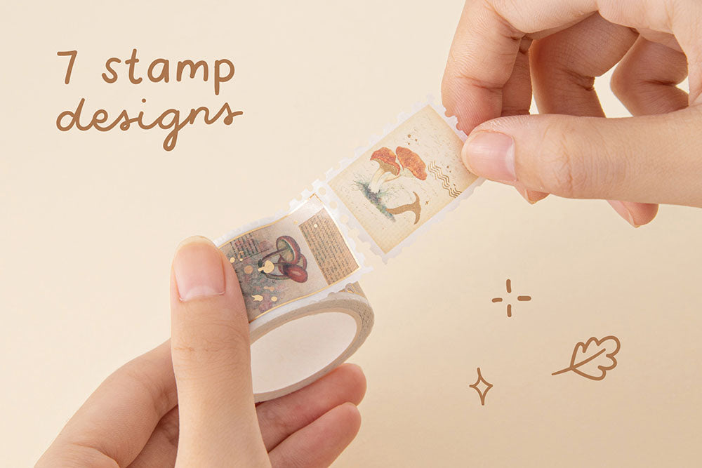 Tsuki 'Maple Dreams' stamp Washi Tape with seven stamp designs held in hands in cream background