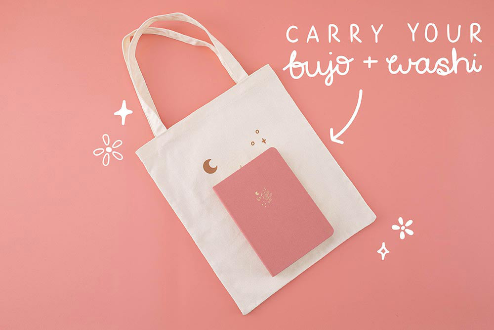 Tsuki 'Moonflower' Limited Edition Tote Bag to carry bujo and washi with 'Suzume' Limited Edition Bullet Journal on coral pink background
