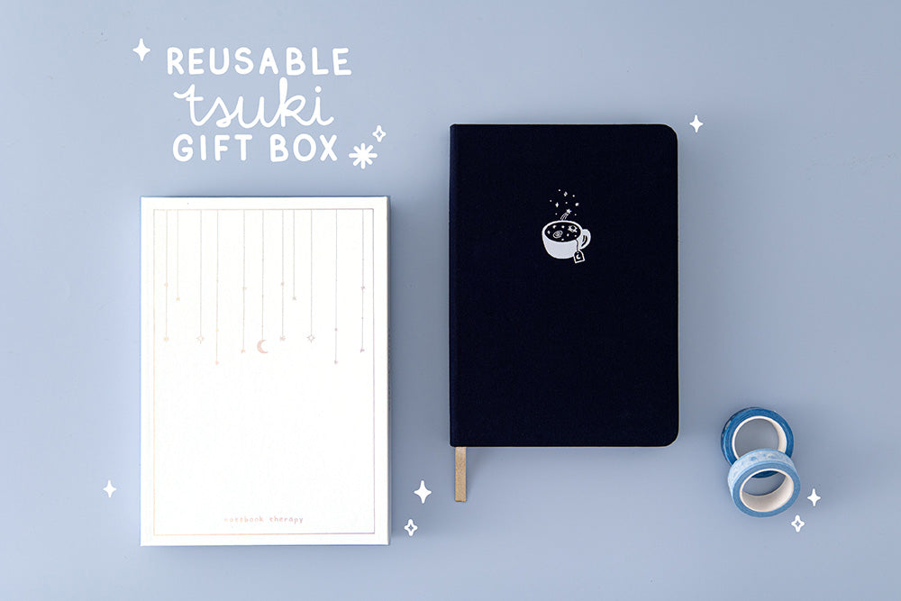 Tsuki 'Cup of Galaxy' Limited Edition Holographic Bullet Journal with luxury eco-friendly reusable gift box and Tsuki 'Cup of Galaxy' Washi tapes on light blue background