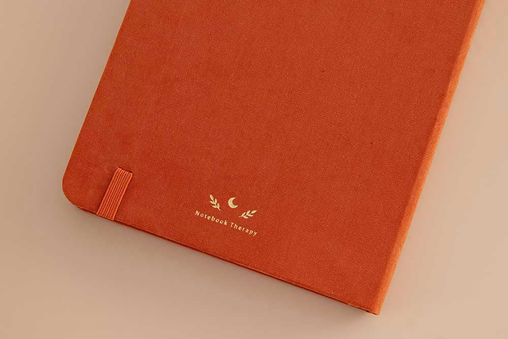 Close up of back cover of Tsuki 'Kitsune' Limited Edition Fox Bullet Journal on beige background