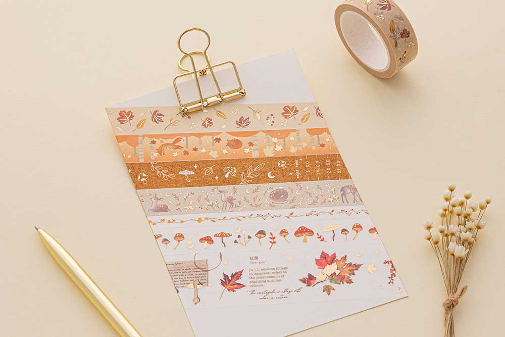 Tsuki 'Maple Dreams' Washi Tapes on bright white clipboard with gold pen and dried flowers on cream background