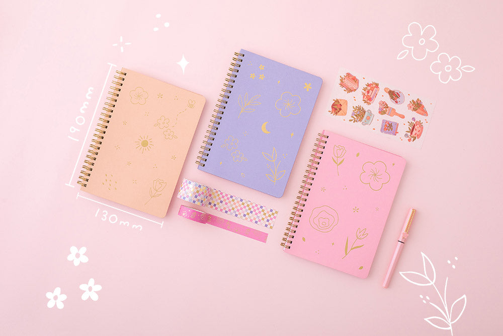Tsuki Floral collection 3 ringbound bujo laid out with sticker sheet and washi tapes, on pink background