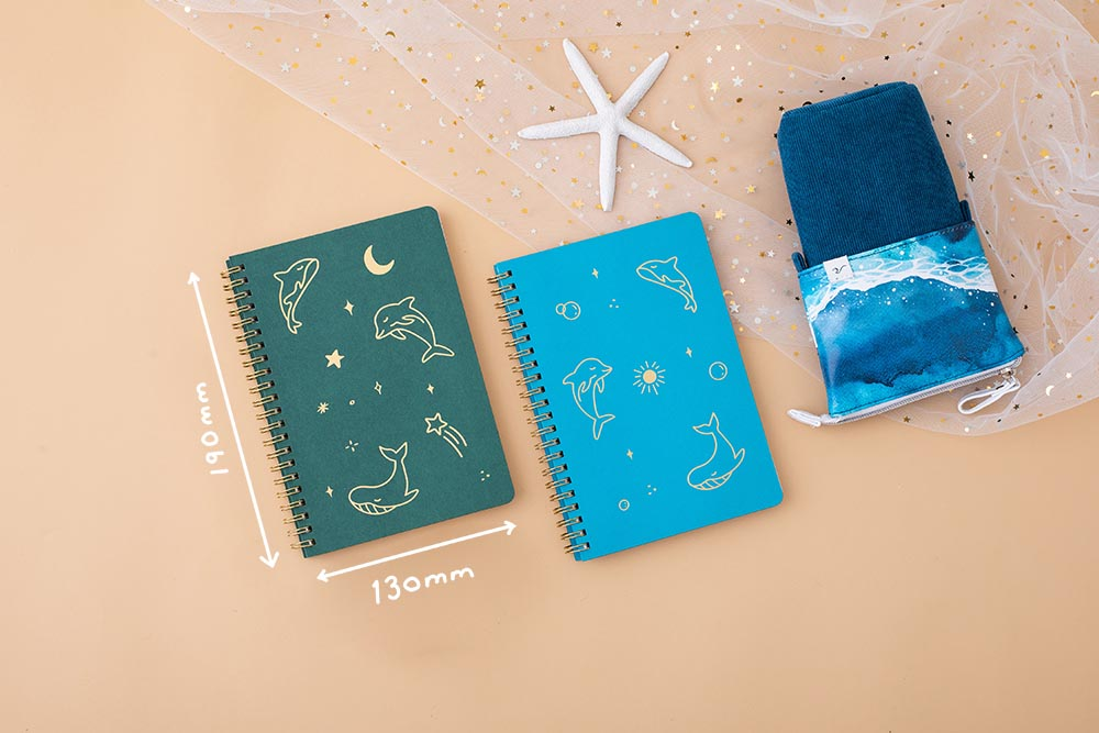 Tsuki Ocean Edition Ring Bound notebooks in aqua blue and deep teal with ocean edition pop up standing pencil case in ocean blue on peach background