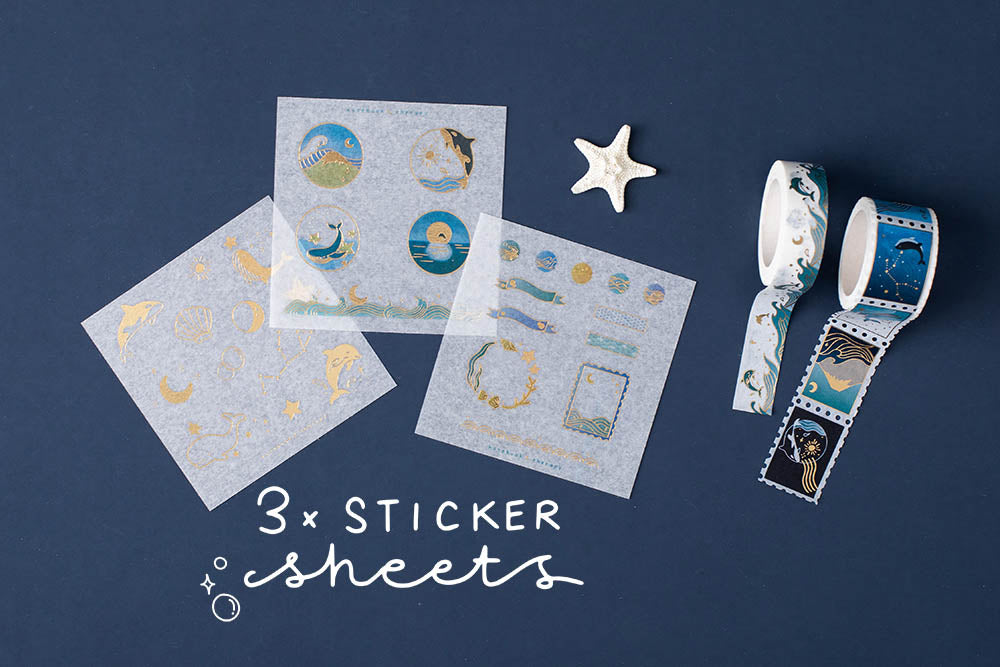 Three Tsuki Ocean Edition sticker sheets with ocean themed washi tapes and starfish on dark blue background