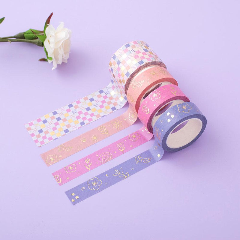 Tsuki Floral washi tapes rolled out on lilac surface