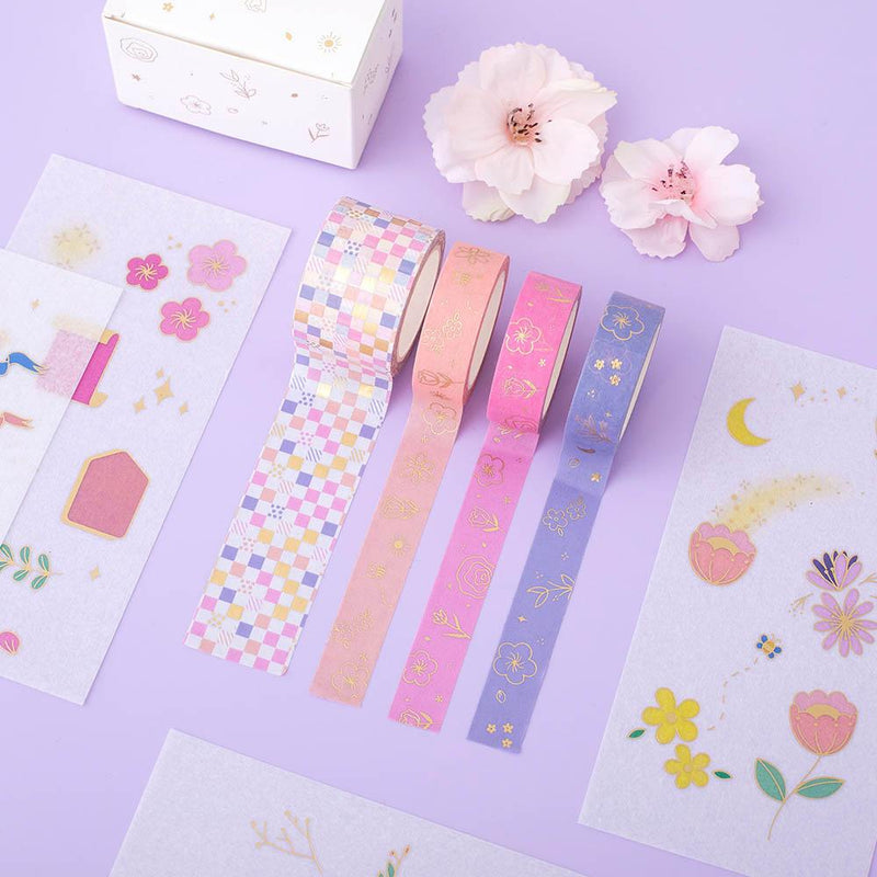 Tsuki Floral washi tapes rolled out with sticker sheets laid on lilac surface