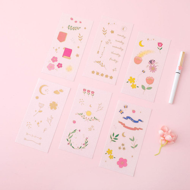 Tsuki Floral collection 6 sticker sheets laid out on pink surface